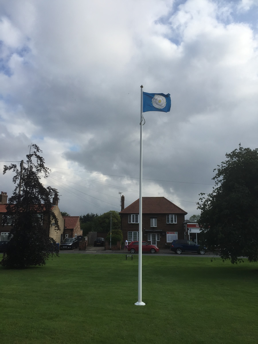 Flying the Yorkshire Flag on the village flag pole